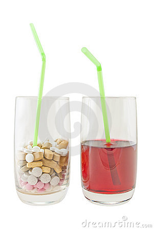 Glass of Vitamin Pills versus Juice - Isolation