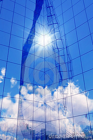 Glass wall and sky reflection