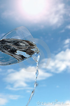 Glass of water against a sunny sky