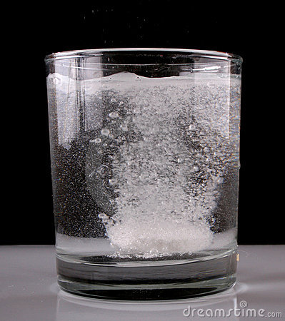 Glass of water with aspirin