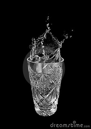 Glass of water and splashes
