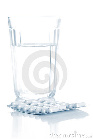 Glass with water and tablets, pills