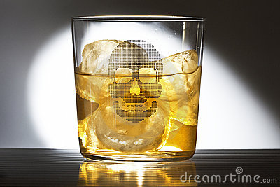 Glass of whiskey with a caravel