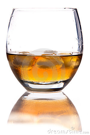 Glass of whisky with ice