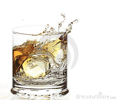 A Glass of whisky with ice cube splash