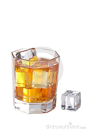 Glass of whisky with ice cubes isolated