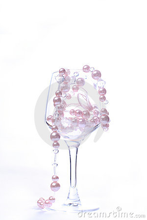 Glass on white background with beads inside