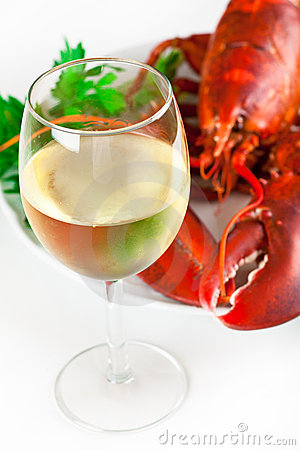Glass of white wine with lobster