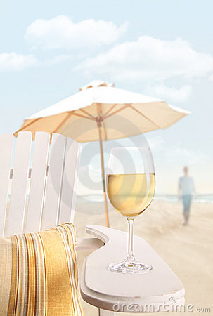 Glass of  wine on adirondack chair at the beach