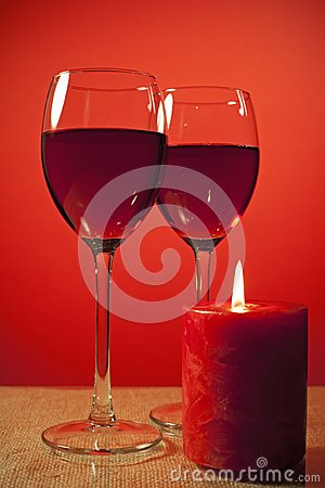 Glass of wine and a candle