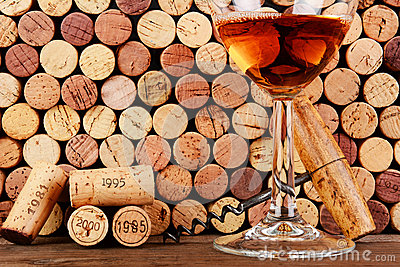 Glass of Wine  in Front of a Wall of Used Corks