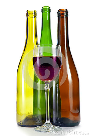 Glass of wine and three empty wine bottles of various color and form on a white background stock - Empty colored wine bottles ...