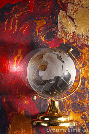 Glass world globe on abstract