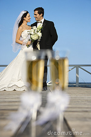 Glasses with bride and groom