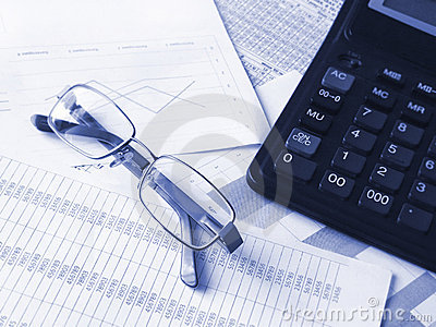 Glasses and calculator on financial documents.