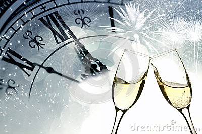 Glasses with champagne against fireworks and clock