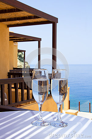 Glasses of champagne on balcony with sea view