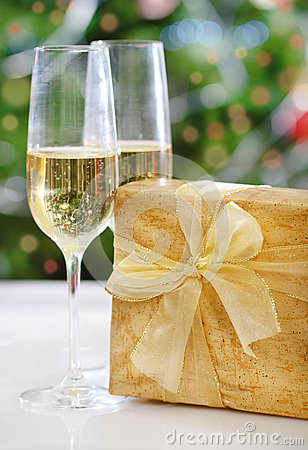 Glasses of champagne and Christmas present