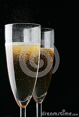 Glasses of champagne over black