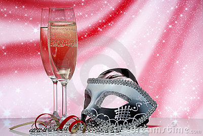 Glasses with champagne and venetian mask