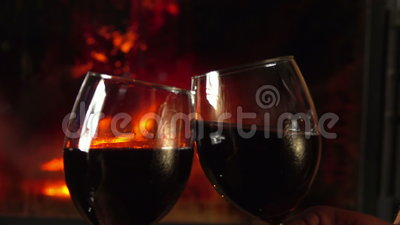Glasses clink at the fireplace. Glasses red wine clink at the fireplace stock video