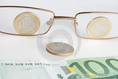 Glasses coins and banknote look like smile