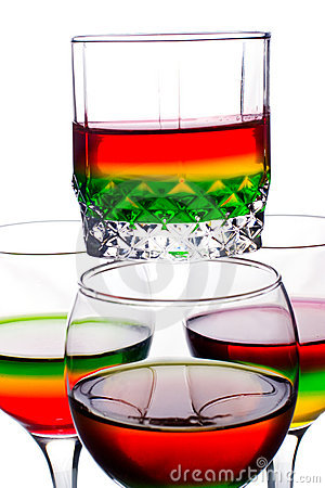 Glasses filled with rainbow coloured alcohol