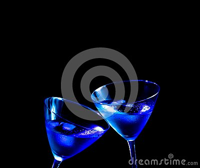 Glasses of fresh blue cocktail with ice make cheers