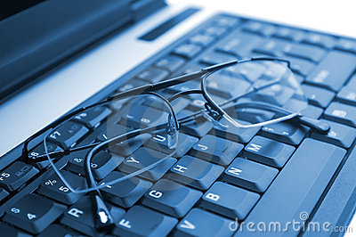 Glasses on laptop