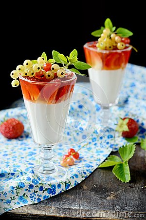 Glasses with a light creamy dessert and berries
