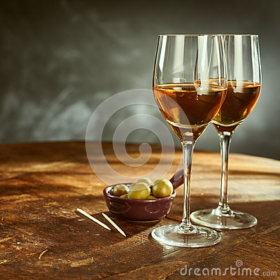 Free Glasses Of Wine On Wooden Table With Green Olives Stock Image - 71535681
