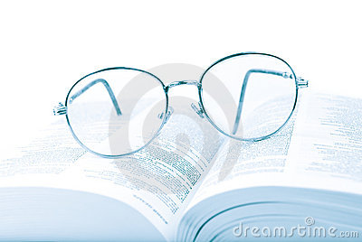 Glasses on the open book