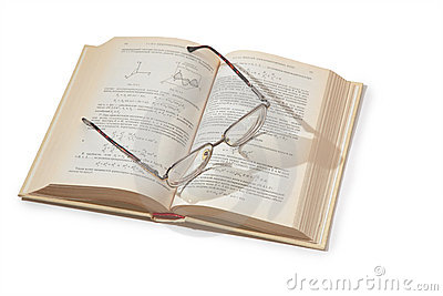 Glasses on opening textbook