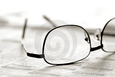 Glasses over Newspaper Classified Section