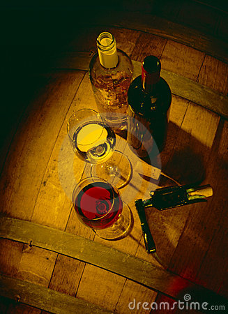 Glasses of red wine with bottles