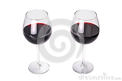 Glasses of red wine.