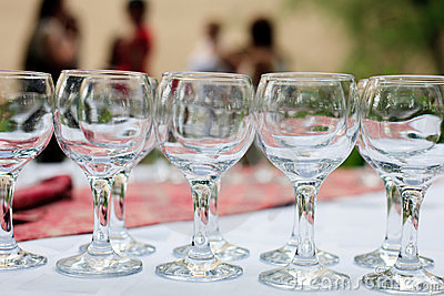 Glasses in rows outdoors Stock Photo