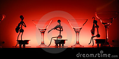 Glasses and statuettes in red light