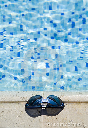 Glasses on a  swimming-pool edge