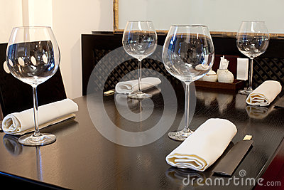 Glasses on table in sushi restaurant