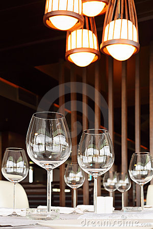 Glasses at table with tablecloth in restaurant