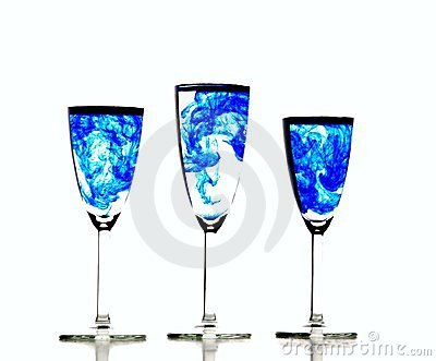Glasses of water with a blue chemical fluid water
