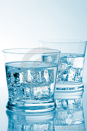 Glasses of water with ice with copyspace
