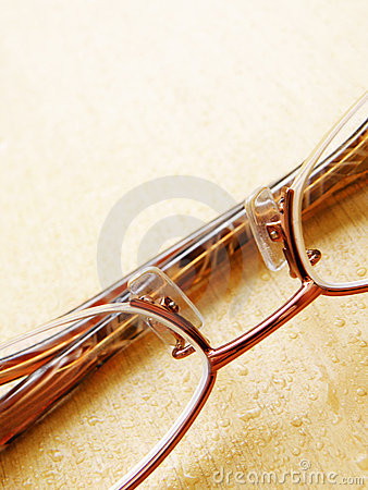 Glasses on wet wood table