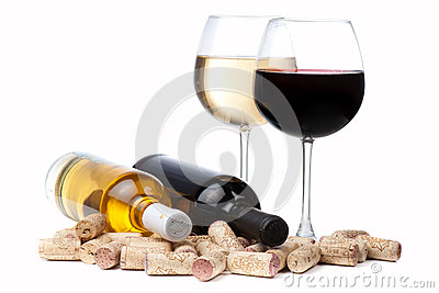 Glasses of white and red wine and corks