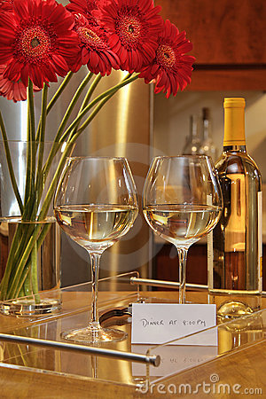 Glasses of white wine with gerbera daisies