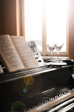 Glasses of wine and piano music