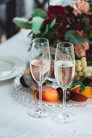 Free Glasses With Champagne Drink On A Table. Happy Newlyweds Drinking. Loving Couple Created New Family. Stock Photos - 108042993