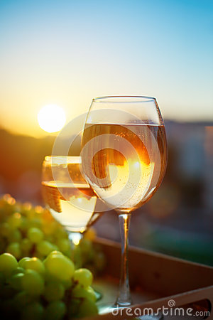 Free Glasses With White Wine At Sunset, With The Reflection Of The Houses. Stock Photography - 98920842