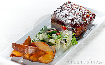 Glazed Pork Ribs with salad and baked potatoes